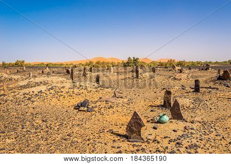 MERZOUGA ,MOROCCO - APRIL 4,2017 - Nomads cemetery in area of Mezouga. A nomad is a member of a community of people who live in different locations moving from one place to another.