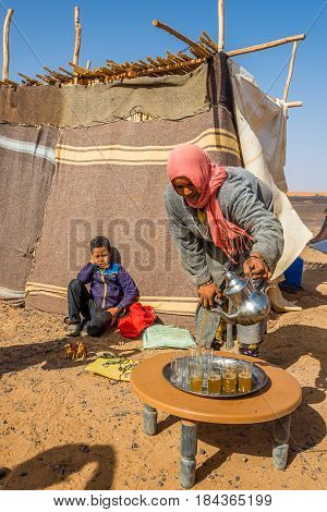 MERZOUGA ,MOROCCO - APRIL 4,2017 - Nomads living in the area of Merzouga. A nomad is a member of a community of people who live in different locations moving from one place to another.