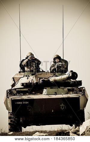 France the training center of the foreign legion - circa 2011. Legionnaires of the 1st Cavalry Regiment of French Foreign Legion on AMX-10 tank during exercises.