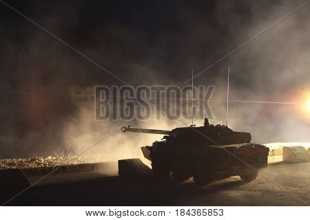 France the training center of a foreign legion - circa 2011. AMX-10 tank belonging to the 1st Cavalry Regiment of the French Foreign Legion during night training firing.