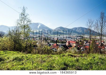 Kysucke Nove Mesto city with hills on the background and clear sky in Slovakia during nice spring day