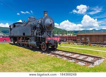 Nova Gorica (Gorizia) - June 2016 Slovenia: Old steam locomotive on rails against the blue sky, the landmark is situated in the city of Nova Gorica, close to the Slovenian- Italian border
