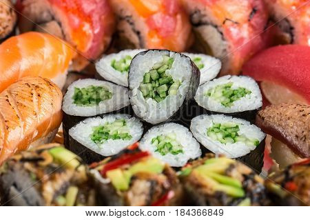 Close up of Kappa maki surrounded by sushi