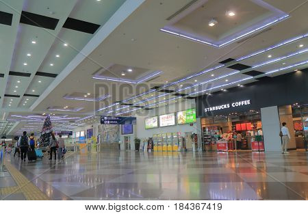 KAOHSIUNG TAIWAN - DECEMBER 16, 2016: Unidentified people travel at Kaohsiung international airport.
