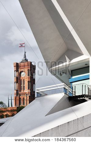 Red Town Hall in Berlin against the white building of Fernsehturm. Germany.