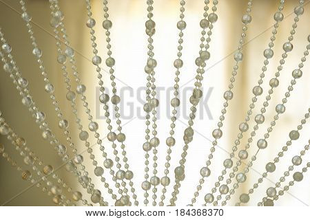 Curtains pearls decoration and backlit background.Modern style