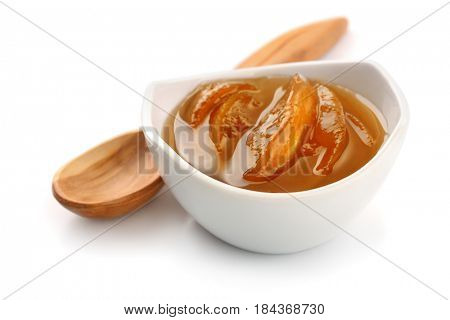 Bowl of peach jam isolated on white