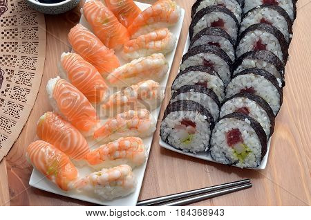 Maki Sushi Rolls And Nigiri Sushi With Salmon And Shrimp Japan Food On The Table Detail