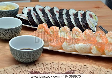 Maki Sushi Rolls And Nigiri Sushi Japan Food On The Table And Soy Sauce