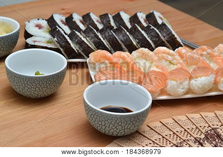 Maki Sushi Rolls And Nigiri Sushi Japan Food On The Table With Soy Sauce