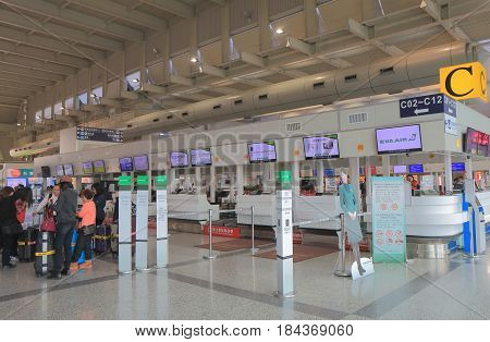 KAOHSIUNG TAIWAN - DECEMBER 16, 2016: Unidentified people check in at Eva air check in counter at Kaohsiung international airport. EVA air is a Taiwanese international airline founded in 1989.