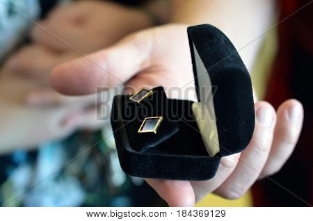 gold diamond plated jewelry earring gift in box in man hand