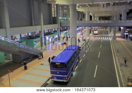 OSAKA JAPAN - DECEMBER 16, 2016:  Unidentified people travel at Kansai international airport bus terminal.