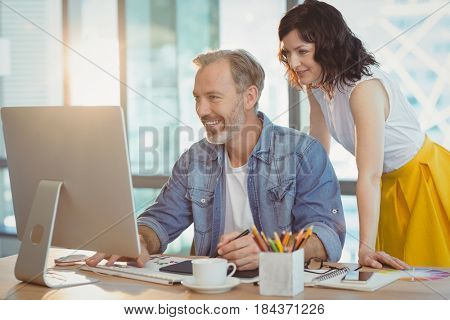 Graphic designers using graphics tablet in office