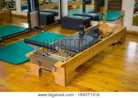Reformer on wooden floor in gym