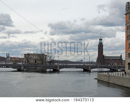 Windy day . Bridges and a city on the islands. Clouds