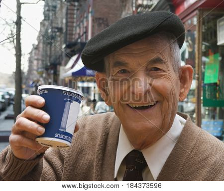 Senior Hispanic man drinking coffee