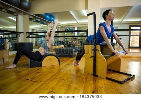 Determined women exercising in gym