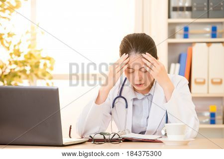 Woman Doctor Stressed With Headache