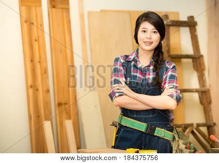 Carpenter Standing In Her Workshop Studio