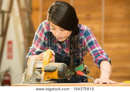 Female Carpenter Using Circular Saw