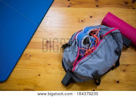 Fitness equipment on wooden floor in fitness studio