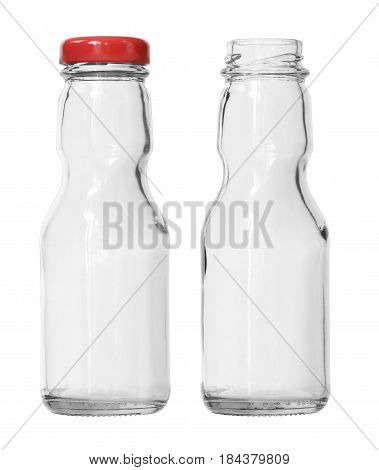 Two Empty Ketchup Glass Bottles with cap and no cap isolated on white background with clipping path