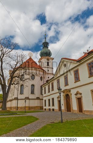 PRAGUE CZECH REPUBLIC - MAY 01 2017: Brevnov Monastery (founded in 993) in Prague. Famous for its brewery and as a basis for Red Rose Mansion (2005) in Naoki Urasawa anime series Monster