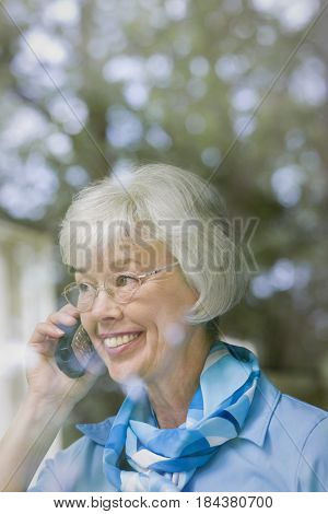 Mixed race woman talking on telephone