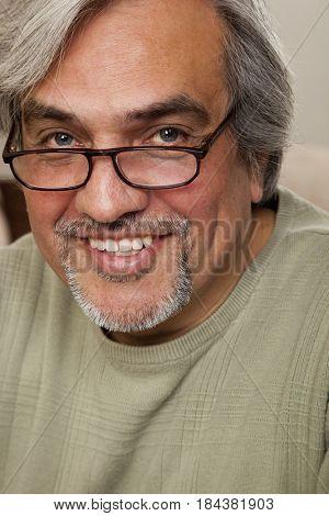 Smiling Hispanic man with goatee and eyeglasses