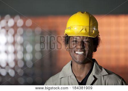 Grinning Black worker in hard-hat