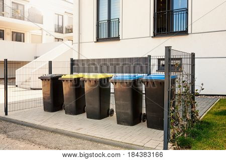 Recycle waste and garbage bins near new residential apartment building environmental protection