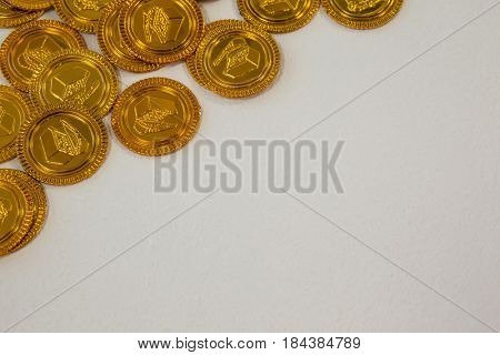 St. Patricks Day close-up of chocolate gold coins on white background