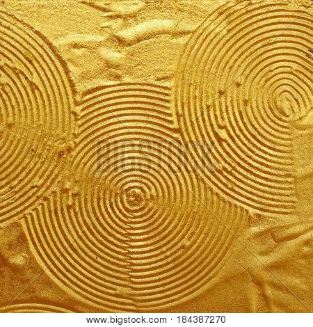 Gold background patterned surface is not smooth for the background.