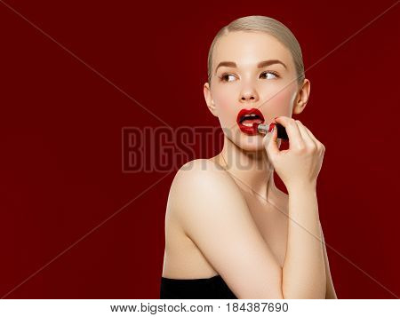 Fashion Photo. Closeup Of Woman Face With Bright Red Matte Lipstick On Full Lips. Beauty Cosmetics,