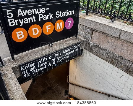 New York USA - September 12 2016: 5th Avenue - Bryant Park station entance sign. Lines B D F M and 7