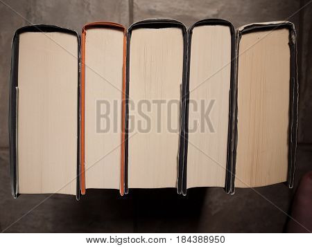 Stack of hardback books from a high angled view