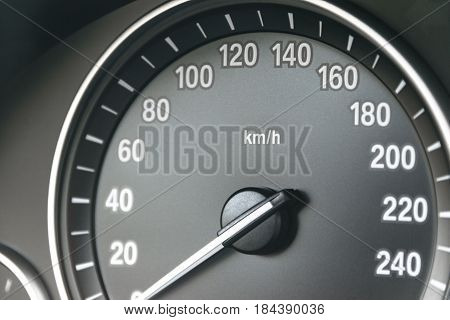 Car instrument panel dashboard closeup with visible speedometer