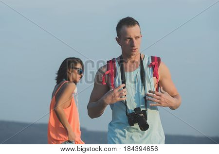 Handsome Man With Camera And Red Backpack In Muscle Hands