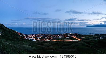 Aerial view to Vila do Corvo and Flores island at sunset in Corvo island Azores Portugal