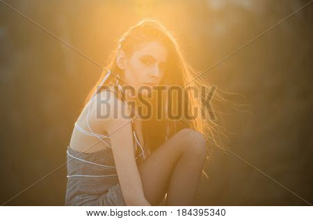 Girl With Long Fashionable Indie Hairstyle On Natural Background