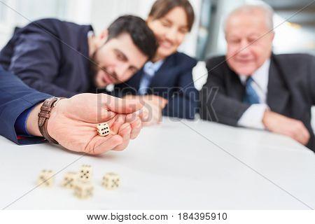 Team having fun playing dice game in business team building seminar