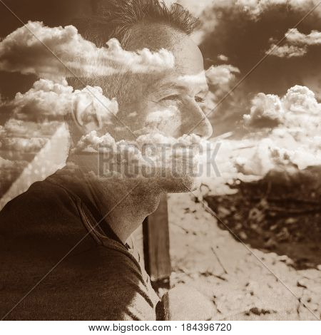 Multi exposure portrait of a thinking man with clouds on the background. Concept - meditation and serenity despite the problems.