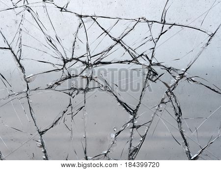 Shattered broken glass window pane close up