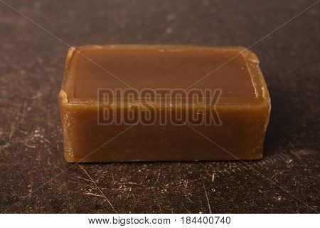 Tar soap on a dark marble background. Personal care. Hygiene