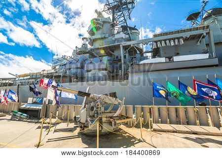 HONOLULU, OAHU, HAWAII, UNITED STATES - AUGUST 21, 2016: machine gun of the battleship Missouri at Pearl Harbor memorial site. National historic and patriotic landmark.