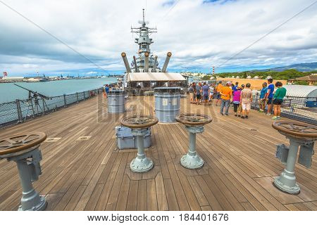 HONOLULU, OAHU, HAWAII, USA - AUGUST 21, 2016: prow with cannons of USS Missouri BB-63 warship at Pearl Harbor base. Commissioned in June 1944 for the World War II. With tourist taking pictures.