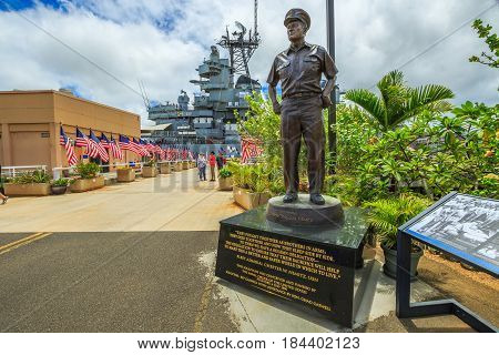 HONOLULU, OAHU, HAWAII, USA - AUGUST 21, 2016: statue of Admiral Chester W. Nimitz at battleship Missouri Pearl Harbor Memorial with American flags. Commander in chief of United States Pacific Fleet.