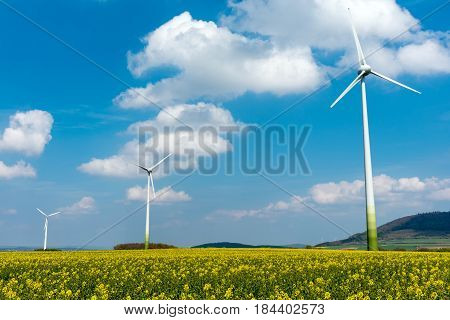 Wind engines in fields of rapeseed seen in Germany