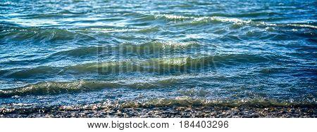 Blue waves on the seashore, closeup view